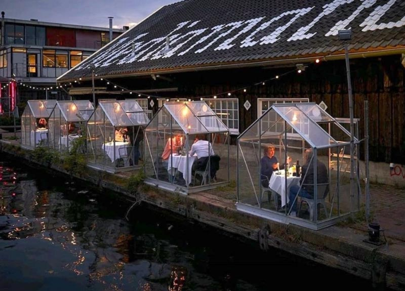 Image of an innovative outside dining alternative from Amsterdam using so called greenhouse quarantine styles