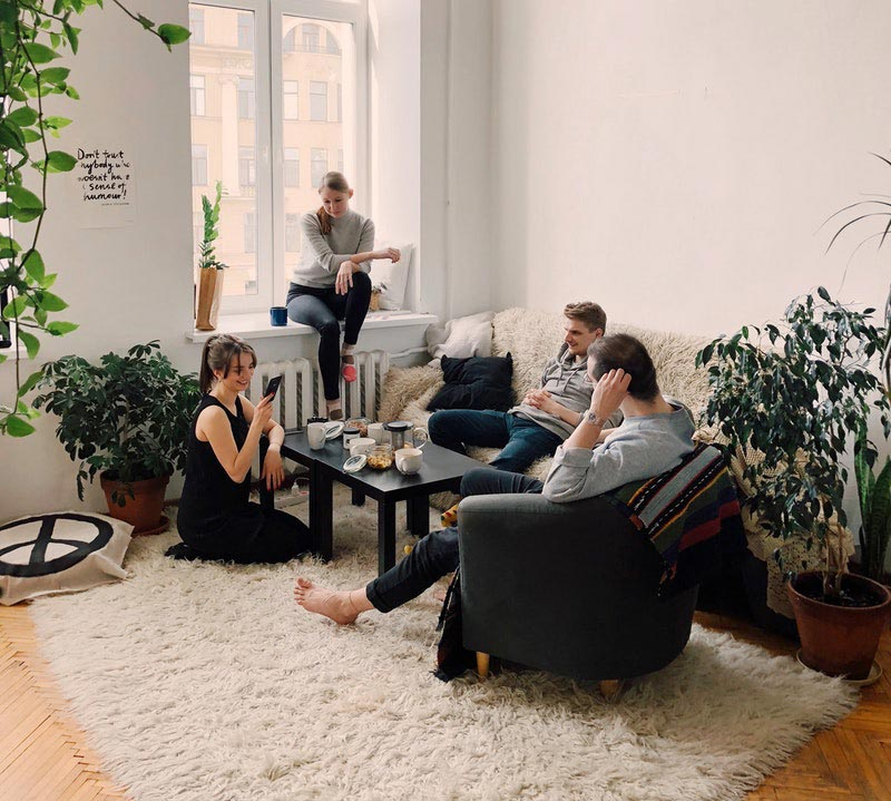 Image of friends at a get together in a small apartment