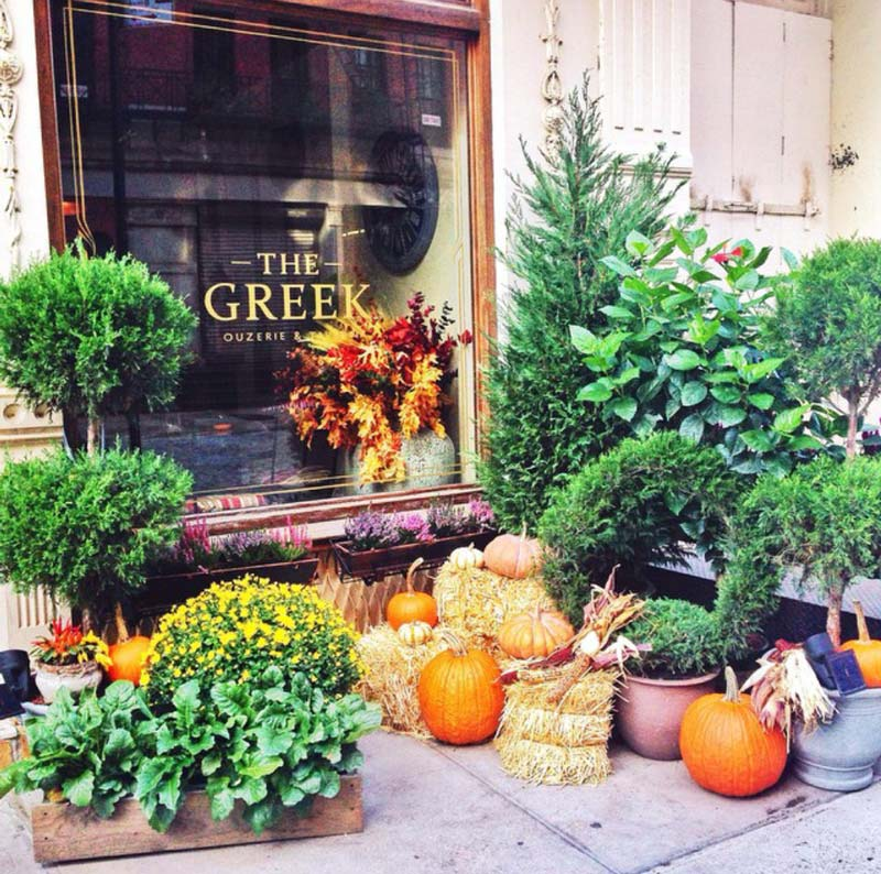 Image of the Greek restaurant exterior decorated for the Fall by Anastasios interiors